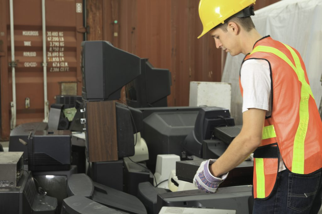 Worker at a recycling facility that handles CRT glass