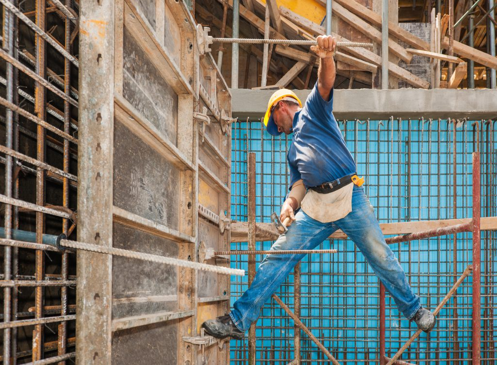 This picture shows a construction worker displaying unsafe work practices, which should be immediately corrected if observed.