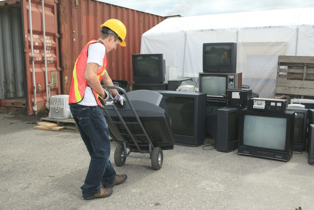 Recycling Worker Moving CRT Televisions